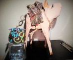 Paper mache pig with saddle trinket holder